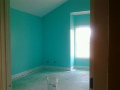 My room :3 Tantalizing Teal from Sherwin Williams is the color.