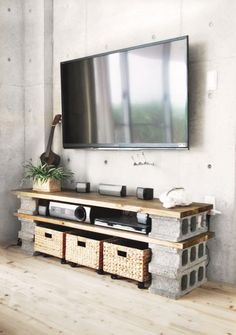 DIY cinder block TV cabinet on a budget. Managed to put it together for under…