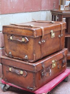love the use of old trunks as side tables or as accessories