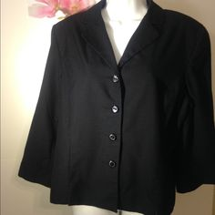 DressBarn Ladies Black Blazer This is a beautiful Dress Barn brand black ladies button up blazer. It is a size 18 and made of 65% polyester and 35% rayon. The lining is made of 100% polyester. It has a collared neck and four buttons in front. The bust is 20 inches, the sleeve is 19.5 inches, and the jacket length is 24 inches. Dress Barn Jackets & Coats Blazers
