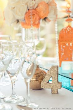 Guest table decor in orange and turquoise with gold accents| Venue Kukua Punta Cana| Design Begokua| Photo by German Paz Photography