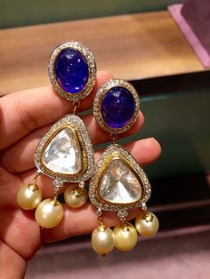 Deep blue tanzanite earrings with diamonds, south sea pearls and big uncut diamonds. A very revered and elegant combination from Jewels by Rakesh Khanna. Gold Jhumka Earrings, Tanzanite Earrings, Gold Bridal Earrings, Jewelry Design Earrings, Gold Earrings Designs, Pearl Jewelry, Wedding Jewelry, Antique Jewelry, Gold Jewelry