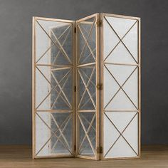 Folding Screens: Setting a folding screen against a bare wall is a great alternative to painting an accent wall. If it's a small room, consider incorporating a mirrored option, like this Weathered Oak Screen with Mirror ($1,495).