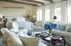 A blue and white geometric rug in an ogival pattern in a master bedroom designed…