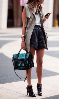 Street Style | Sleeveless Trench Coat with White Button Down Tee, Black Shorts, Statement Necklace, Emerald & Black Purse and Rockin' Leather Lacey Heels | pinned from: www.shopdailychic.com/collections/bottoms/products/new-york-calling-leather-look-skirt-black| | { Couture /// In the Details 2