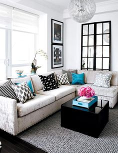 I love the black, white, and small color accent idea.  For our new living room...although probably a different color.