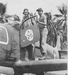 Lieutenant Leder (Leder) and aircraft technician standing on the wing of a fighter P-39D «Cobra» (Bell P-39D Airacobra) from the 35th Fighte...