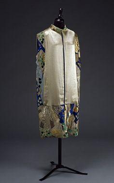 Sleeveless evening coat, mid-calf, Natalia Goncharova for Maison Myrbor.  Silk with random patchwork, open front.  Victoria and Albert Museum