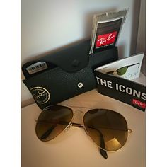 Authentic Ray Ban Aviators. 62mm, always sold out! Brown/gold large Ray Ban aviators - always sold out in stores. Brand new, wore once. Includes, case, original and unopened cleaning cloth and ray ban book. Completely authentic, even have the Macy's return sticker still on the case. They are 62 mm, perfect for a dramatic look. Only reason I want to sell is because I want to get Porsche sunnies soon  Make an offer, let's NEGOTIATE. Ray-Ban Accessories Sunglasses