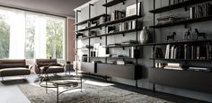 airport | in evidence - Modular wall- or ceiling-hanging bookcase. Brackets and pillars in white (GFM71), black (GFM73) or graphite (GFM69) embossed lacquered steel. Shelves and container in Canaletto walnut (NC), burned oak (RB), embossed white (GF71) or graphite (GF69) painted wood.