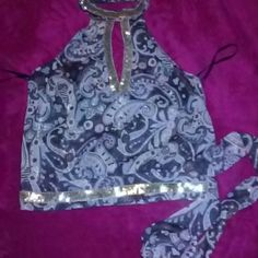 Very cute OXOXO collection blouse Paisley style work brown, pink, blue n white colors with silver streaks throughout. Shiny look very pretty. Has silver sequence around wait and neck area. Ties on the side. Very very cute ?? oxoxo Tops Blouses