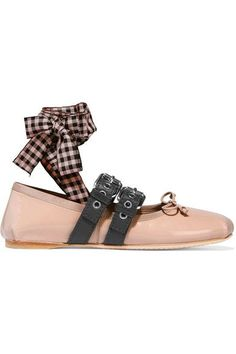 Miu Miu's revamped ballet flats are the must-have shoe for the season. Made from blush patent-leather, this comfortable pair has two buckled straps and removable gingham and pink ties that wind around the ankle. Highlight yours with cropped hemlines.