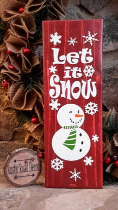 Rustic Christmas Sign features a rustic snowman with snowflakes and reads Let It Snow. Why wait until the last minute to get your Christmas decor when you can start now. It can be propped on a mantel, around the Christmas tree, or add a hanger and hang it on the wall. This rustic Let It Snow Christmas sign is made from reclaimed pine wood. This sign is stained a rustic barn red and hand painted and sealed. If you would like a different color, please message us and let us know. We love…