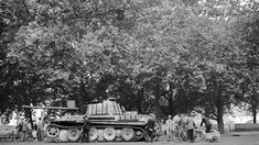 Parisians with an abandoned Pz.Kpfw.V Ausf.G Panther in the Luxembourg garden. 1944