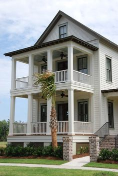 double porch with ceiling fans @ traditional exterior by JacksonBuilt Custom Homes
