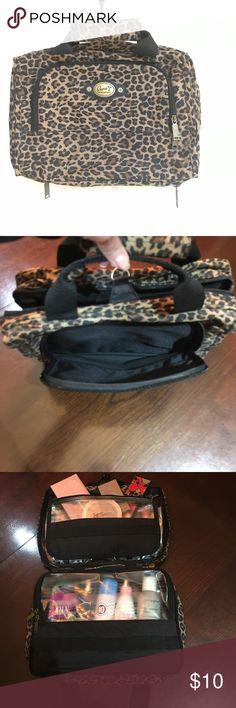 Cheetah Print Cosmetic/Toiletry Bag Cheetah print cosmetic/toiletry bag. Very nice & spacious. It has 4 different storage pockets. One of them has 5 dividers for product storage. It's a great bag for traveling. You can take everything you need in one bag! Products shown in bag are for display purposes only. They do not come with the bag. ricardo beverly hills Bags Cosmetic Bags & Cases