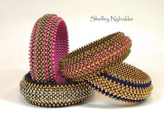 Do what you love, love what you do. My very first bangle, my very first publication (Bead & Button June 2007). Layered Right Angle Weave. At the time I designed this, I was teaching myself right angle weave. One layer just looked so boring to me. And oddly enough I found a hole