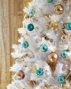 White Christmas tree with torquoise and bronze ornaments
