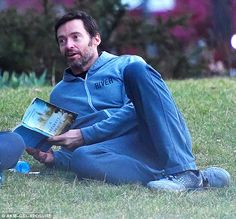 Relishing the moment: Hugh Jackman takes time out from busy Eddie the Eagle promo tour to enjoy some bonding time with his son Oscar and friends