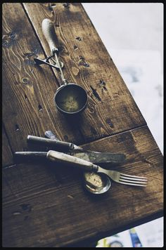 Antique Kitchen Utensils on Rustic Homemade Table