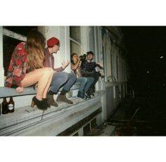 Looks like a scene out of Cool Kids by Echosmith. I would love to live in this balcony setup, downtown, just me + the homies