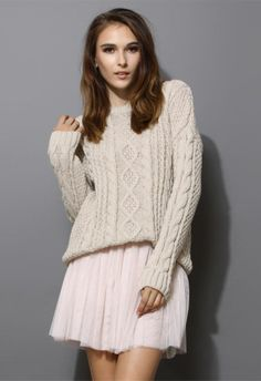 feminine skirt paired with chunky sweater