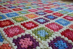 Tadpegs: Soduku Blanket, a bright coloured granny square crochet blanket.