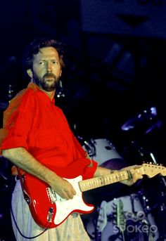 Eric Clapton performing live in concert at the NEC