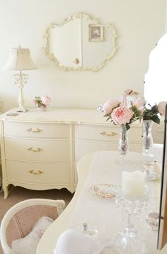 LOVE THIS ALL WHITE ROOM--PINK ROSE SEEMS TO BE THE FOCAL POINT.....