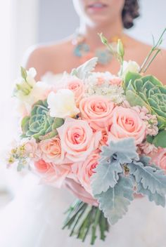 Rustic Coral and Succulent wedding flowers. Dusty miller, coral roses, peach stock, queen ann lace, spray roses, and lisianthus. Country rustic wedding.