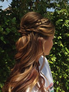 Bridesmaid or prom hairstyle. Half up half down worn to the side curls with a braid. By Kaylin Laporte