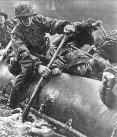Waffen SS crossing a river.