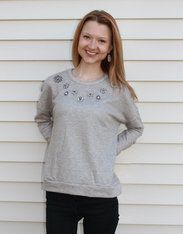 Embellished Luxe Gray Sweater Get fancy with these floral embellishments on either a pale pink or light gray luxe sweater. Tis the season to subtly sparkle! White Barn Boutique