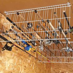 Wire shelving into rack for fishing poles! (from 18 life-changing storage ideas)