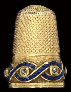 An English gold and enamel diamond set thimble, circa 1860.