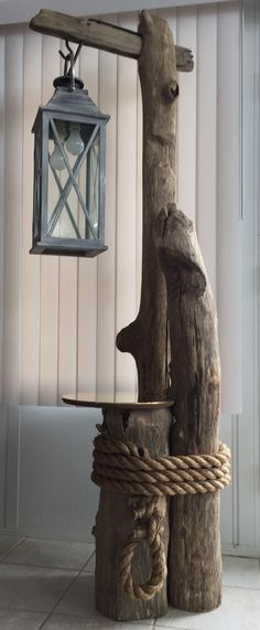 "Starting Woodworking Business Ohio River driftwood, converted lantern, brass table top, and massive rope all come together perfectly for this awesome ""nautical feel"" floor lamp. Driftwood Flooring, Driftwood Art, Driftwood Table, Driftwood Furniture, Into The Woods, Rustic Outdoor, Outdoor Decor, Nautical Decor Outdoor, Nautical Deck Ideas"