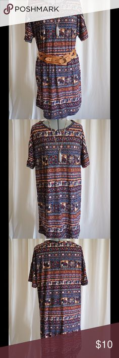 """Vibrant T-Shirt Dress Feeling inspired to travel? This comfortable dress will have you reaching for your camera.  Accessorize with a belt, necklace, sun hat & cute sandals. This is in NWOT condition. The fabric has a light drape yet feels like a soft velour.  The colors are gorgeous - denim blue, scarlet red, soft peach & yellow.  No filters are used on these photos. The dress measures: bust-47"""", waist-45"""", hips-47"""", front length-35"""" @ middle neckline & back length-39"""" @ middle neckline…"""