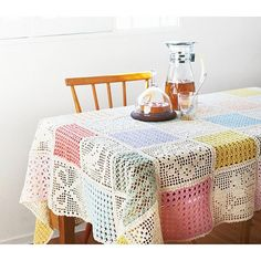 Inspiration only Beautiful Springtime tablecloth made from  pastel crochet blocks <3