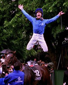 Frankie Dettori jockey does his famous flying dismount after winning The Gold Cup at Royal Ascot on Kayf Tara Mirrorpix. Photo by Edward Whitaker.