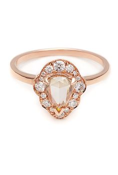 """Brides.com: . """"Camelia Petal"""" ring, 0.64ct rose-cut pear shaped diamond with .17ctw white diamond frame in 14kt yellow gold, $5,750, Anna Sheffield"""