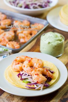 """sweet Chile Shrimp Tacos with cool avocado cream recipe from A Spicy Perspective!! """"Simple zesty tacos with international appeal. Spicy sweet chile shrimp tacos, with crunchy jicama slaw and cool avocado cream is just the kind of meal I like to serve out on the deck on a warm spring evening."""""""