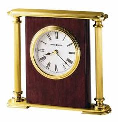 Howard Miller brass-finished Tabletop Clock ROSEWOOD BRACKET 645104-Fluted brass-finished columns, top and base frame the center panel finished in a high-gloss Rosewood on select hardwoods.