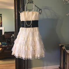 Masquerade dress. MASQUERADE Lace Belted Strapless Homecoming Dances Dress Size: 11/12 a make up stain inside once it's on you can't see it. Other than that good condition. Masquarade Dresses Strapless