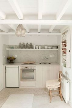 Frustrated with your tiny kitchen? These tips can help you learn to love your small space! There's something special about compact kitchens, especially because they use less energy. For more on tiny kitchen organization, head to Domino! Cozy Kitchen, Rustic Kitchen, Kitchen Decor, Kitchen Ideas, Kitchen White, Petite Kitchen, Barn Kitchen, Basement Kitchen, Stylish Kitchen