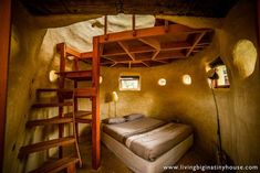 Cozy cob bedroom~ Cob is generally warm in the winter and cool in the summer. Use a passive solar design and strawbales on the north walls for increased insulation. A loaded bookshelf on this wall will add even more~ #cobbedroom#cob#stairway