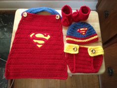 Hand crocheted baby Superman 4 piece set includes all items pictured. Set is made from soft acrylic yarn in a smoke free home. Makes a great photo