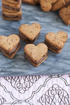 Heart shaped coconut flour, healthy cookie sandwiches. These are a must make for your Valentine's Day.  Grain free | dairy free | gluten free | via purelytwins