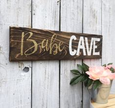 Babe Caves are way cooler than man caves! Every classy girl needs here babe cave and heres the perfect decor!  This sign comes ready to hang.  Dimensions: approx 21 in wide by 5.5 high  All wood used at Eco Art Wood Design is reclaimed and re-purposed. We strive to build beauty out of the discarded from old fences and decking, furniture and pallets to fallen trees in the forest. Our purpose is to give new life to old wood. Got a custom idea? Let us know, wed love to work with you…