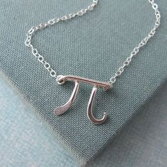 Pi necklace in sterling silver by Laladesignstudio on Etsy, $50.00    I may just order this for my birthday tomorrow...!!!