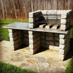 Nice backyard natural stone grill www.getaninspector.com 615-905-6308